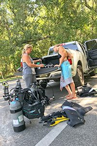 Image of Two Ladies Preparing for Cave Dive