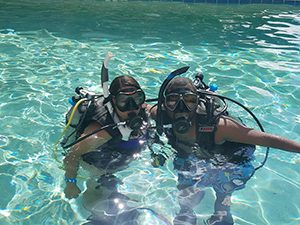 Image of Two Divers in Pool Setting During Open Water Certification Course Training